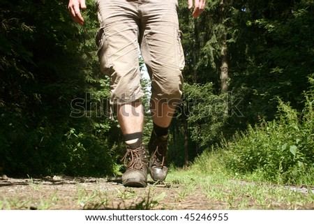 Legs with hiking boots of a wanderer in the german Sauerland mountains - stock photo