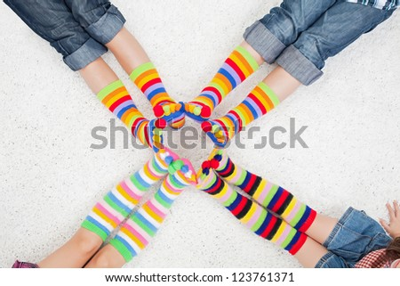 Legs with long colorful socks