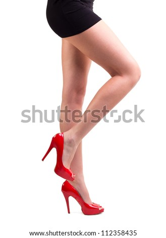 legs with red high hill shoes isolated on white background - stock photo