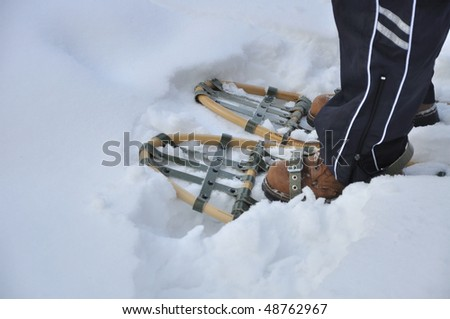 Legs with snowshoes - stock photo