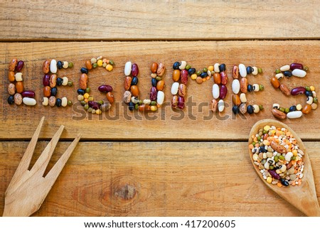 Legumes word with wood background - food - stock photo