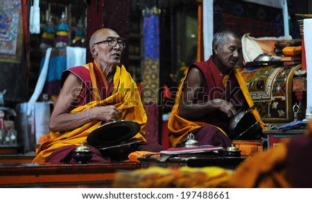 LEH IN LADAKH, INDIA - SEPTEMBER 17 2012: Unidentified buddhist monks are praying in Spituk monastery in Leh. The majority of the local population are descendant of Tibetan. - stock photo