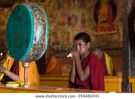 Leh, India â?? AUGUST 23, 2007: Buddhist monk playing on shell during buddhist ceremony at Thiksay Monastery. - stock photo