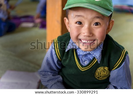 Leh, India - August 24, 2015: View of a smiling tibetan student in SOS Children's Village school. SOS Children's Village is an integrated educational community for destitute Tibetan children in exile. - stock photo