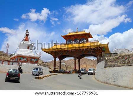LEH/INDIA - JULY 02. Beautiful city view with buddhist style gate on July 02, 2013 in Leh, Ladakh, Jammu & Kashmir, India. About 100 thousand tourists visit this high mountain town yearly. - stock photo