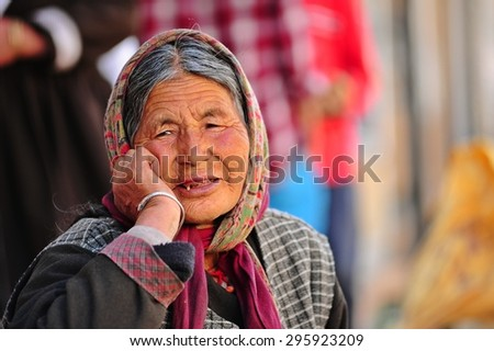 LEH, INDIA. JUNE 20, 2012 : The old woman selling at local market in state of Jammu and Kashmir , North of India