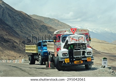 LEH, INDIA. JUNE 14, 2012 : Unidentified man working maintenance on truck close himalayan mountain at Leh, India - stock photo
