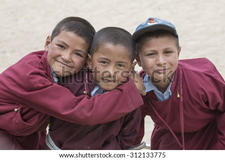 LEH, INDIA - JUNE 24, 2015: Unidentified Tibetan students in a lesson on Sport in Druk White Lotus School