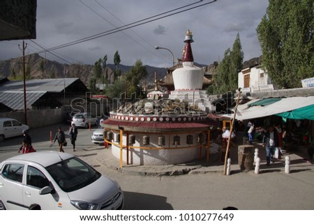 LEH, INDIA - SEP 11, 2017 - Stupa and chorten at busy intersection in Leh, Ladakh, India
