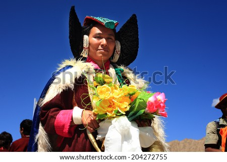 LEH, INDIA - SEPT 01 : An unidentified Ladakhi tribal woman in her  traditional wear poses as she walks in a cultural procession during Ladakh Festival on September 01, 2012 in Leh, India. - stock photo