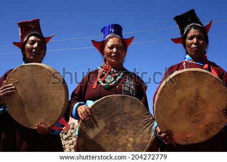 LEH, INDIA - SEPT 01 : Unidentified Ladakhi tribal women holding traditional drums participate in a cultural procession during Ladakh Festival on September 01, 2012 in Leh, India. - stock photo