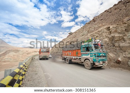 LEH LADAKH , INDIA - AUGUST 11 : The big colorful trucks on Indian Himalayas high altitude road in Leh Ladakh,India on August 11, 2015.