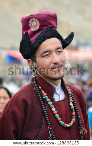 LEH, LADAKH, INDIA - SEPTEMBER 08, 2012: Close up portrait of Man in traditional tibetan costumes. Last day of Annual Festival of Ladakh Heritage in Leh, India. September 08, 2012.