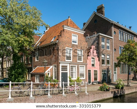LEIDEN, NETHERLANDS - SEP 5, 2015: Old houses on Groenhazengracht canal in the old city centre of Leiden in South Holland