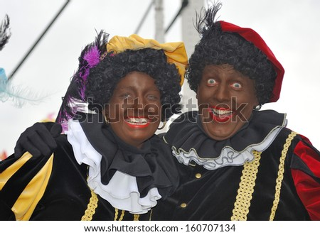 LEIDSCHENDAM, THE NETHERLANDS - NOVEMBER 13, 2010: Two Black Petes laughing in the camera during the arrival of Sinterklaas in Holland. November 13, 2010 Leidschendam, Holland