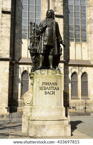 LEIPZIG, GERMANY - APRIL 8, 2016. Statue of Johann Sebastian Bach in Leipzig, with Thomaskirche in the background.