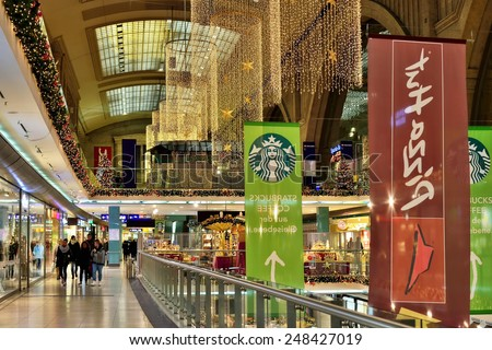 LEIPZIG, GERMANY-DECEMBER 21, 2014: Interior of Leipzig Central Railway Station and shopping center Westhalle. This is the largest railway station in the world. Long exposure image