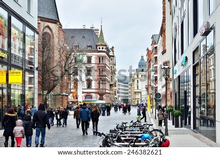 LEIPZIG, GERMANY-DECEMBER 21, 2014: People walking to traditional Christmas Market in historical center of Leipzig - stock photo