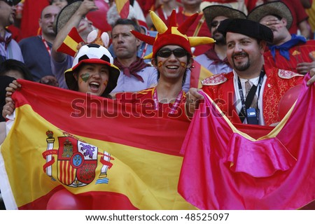 LEIPZIG, GERMANY - JUNE 14:  Spain supporters at a 2006 FIFA World Cup soccer match beween Spain and Ukraine June 14, 2006 in Leipzig, Germany. - stock photo
