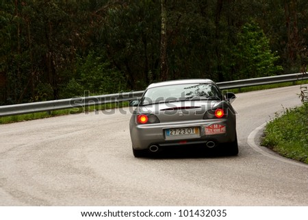 LEIRIA, PORTUGAL - APRIL 20: Orlando Almeida drives a Honda S2000 during Day One of Rally Verde Pino 2012, in Leiria,  Portugal on April 20, 2012.