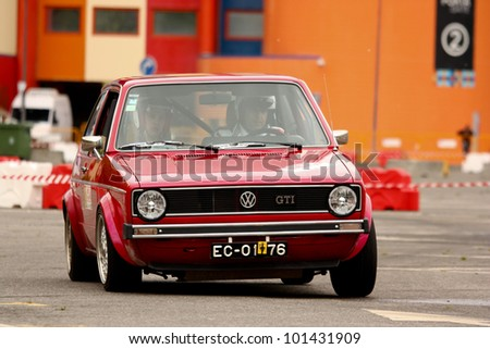 LEIRIA, PORTUGAL - APRIL 22: Paulo Silva drives a VW Golf GTI during Day Three of Rally Verde Pino 2012, in Leiria, Portugal on  April 22, 2012.