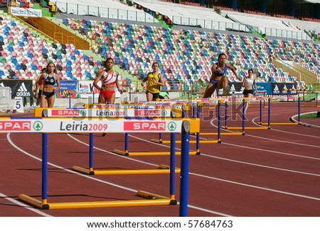 LEIRIA, PORTUGAL - JULY 18: Portuguese Athletics Championship,400 meters hurdles women , July 18, 2010 in Leiria, Portugal - stock photo