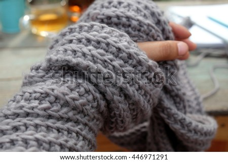 Leisure activity at free time in garden, women hand knitting scarf from yarn, meaningful lifestyle by doing hobby, a present for winter