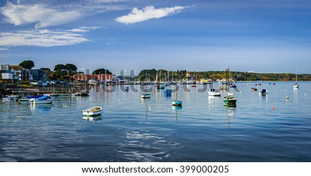 Leisure and fishing boats in Poole Harbour in Dorset, looking out to Brownsea Island from Sandbanks - stock photo