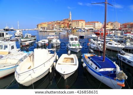 Leisure and fishing boats inside the harbor of Rovinj, Croatia - stock photo