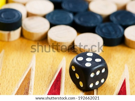 Leisure: backgammon with chips and dice. - stock photo