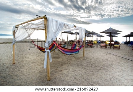 leisure bed hanging bed and umbrella on tropical beach - stock photo