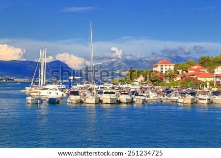 Leisure boats anchored in Adriatic sea harbor, Trogir, Croatia - stock photo