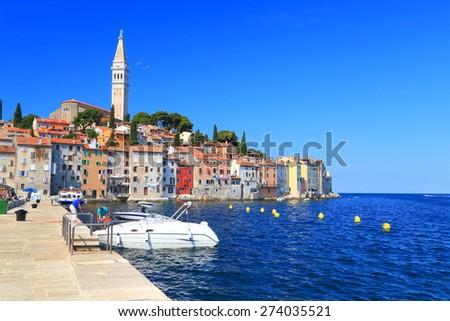 Leisure boats anchored inside the harbor of old Venetian town, Rovinj, Croatia - stock photo
