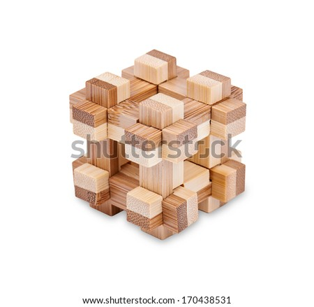 Leisure - challenging puzzle block of wooden parts isolated on a white background with light shadow. Image includes a clipping path.   - stock photo