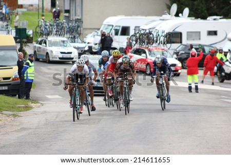 LELEX, FRANCE - AUG 15: Small pack of professional cyclists riding Le Tour de l'Ain UCI Europe Tour Pro Race on August 15, 2014 in Lelex, Monts du Jura, France. Bert-Jan Lindeman won the race. - stock photo