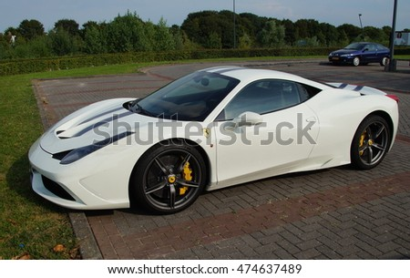 Lelystad, The Netherlands - August 27 2016: White Ferrari 458 Italia on a public parking lot in the city of Lelystad. Nobody in the vehicle.