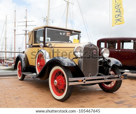 LELYSTAD, THE NETHERLANDS - JUNE 17: A 1930 Ford A Tudor on display at the annual National Oldtimer day on June 17, 2012 in Lelystad, The Netherlands - stock photo