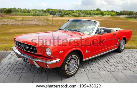 LELYSTAD, THE NETHERLANDS - JUNE 17: A 1965 Ford Mustang Convertible on display at the annual National Oldtimer day on June 17, 2012 in Lelystad, The Netherlands - stock photo