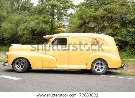 LELYSTAD, THE NETHERLANDS - JUNE 19: A 1960s Morris Minor Traveller on display at the annual National Oldtimer day, held June 19, 2011 in Lelystad, The Netherlands - stock photo