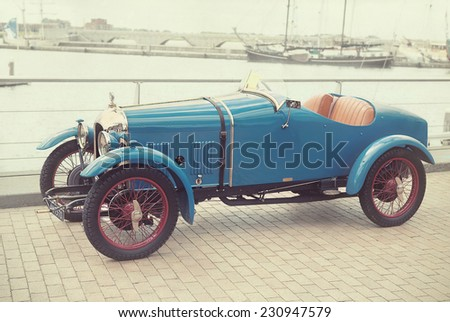 LELYSTAD, THE NETHERLANDS - JUNE 17, 2012: 1927 Amilcar CGSs on display at the annual National Oldtimer day. Textured filtered image in a nostalgic retro style.   - stock photo