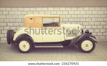 LELYSTAD, THE NETHERLANDS - JUNE 15, 2014: 1930 Citroen AC 4 on display during the annual National Oldtimer day. Textured filtered image in retro nostalgic look.  - stock photo