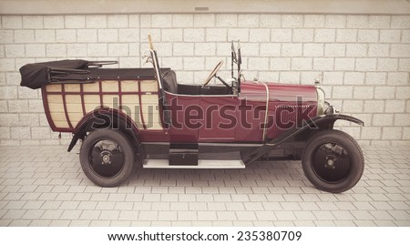 LELYSTAD, THE NETHERLANDS - JUNE 15, 2014: 1924 Citroen B2 Normande on display during the annual National Oldtimer day.Textured filtered image in nostalgic retro style.  - stock photo