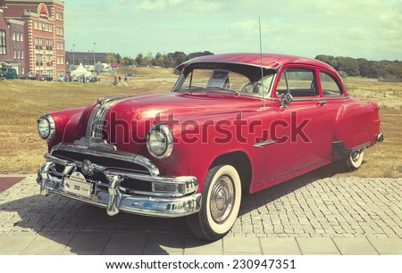 LELYSTAD, THE NETHERLANDS - JUNE 17, 2012: 1953 Pontiac Chieftain is on display at the annual National Oldtimer day. Textured filtered photograph in a retro nostalgic style.  - stock photo
