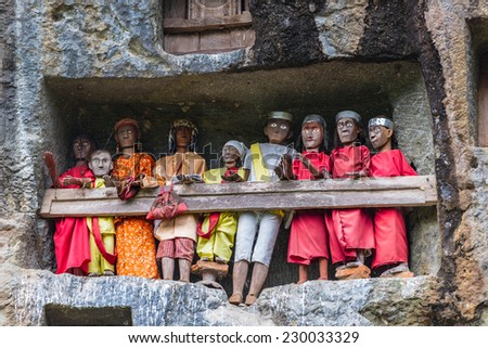 Lemo (Tana Toraja, South Sulawesi, Indonesia), famous burial site with coffins placed in caves carved into the rock, guarded by balconies of dressed wooden statues, images of the dead persons.