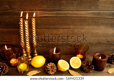 Lemon and aroma candles.image of aromatherapy on autumn and winter season.