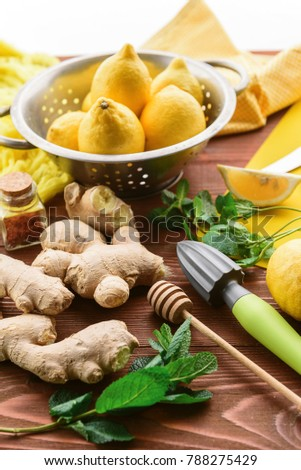 lemon and ginger with mint and honey. on a wooden background in a rustic style.