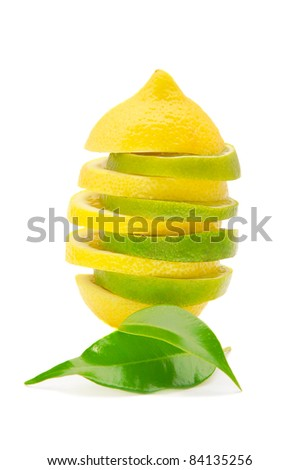 lemon and lime pyramid with leaves isolated on white background - stock photo