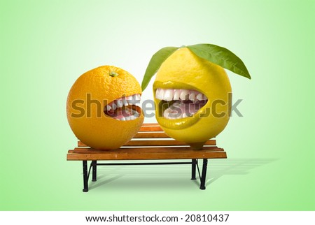 lemon and orange laughing together over a seat - stock photo