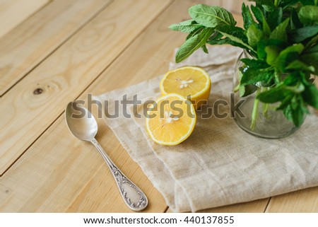 lemon and sorrel on fabric in wooden interior background