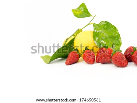 LEMON AND STRAWBERRIES WITH LEAVES ON WHITE BACKGROUND